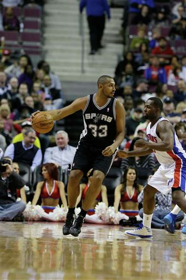San Antonio Spurs forward Boris Diaw (33) of France is defended by Detroit Pistons guard Rodney Stuckey during the second half of an NBA basketball game at the Palace of Auburn Hills, Mich., Monday, Feb. 10, 2014. (AP Photo/Carlos Osorio) Photo: Carlos Osorio, AP / AP
