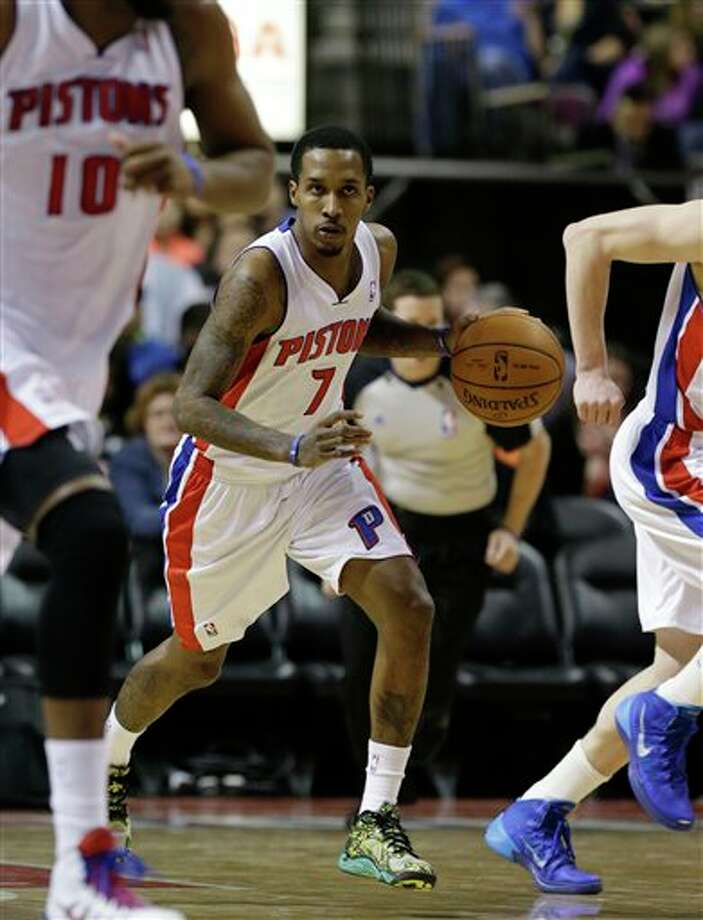 Detroit Pistons guard Brandon Jennings (7) brings the ball downcourt during the second half of an NBA basketball game against the San Antonio Spurs at the Palace of Auburn Hills, Mich., Monday, Feb. 10, 2014. (AP Photo/Carlos Osorio) Photo: Carlos Osorio, AP / AP