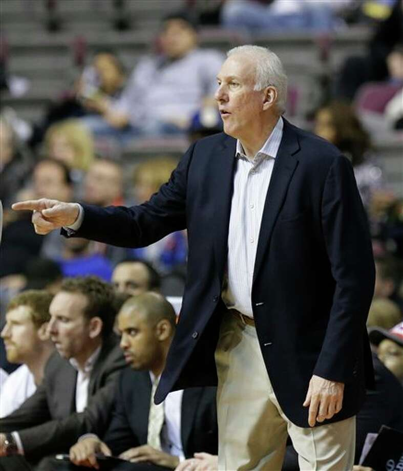 San Antonio Spurs head coach Gregg Popovich directs from the sidelines during the second half of an NBA basketball game against the Detroit Pistons at the Palace of Auburn Hills, Mich., Monday, Feb. 10, 2014. (AP Photo/Carlos Osorio) Photo: Carlos Osorio, AP / AP
