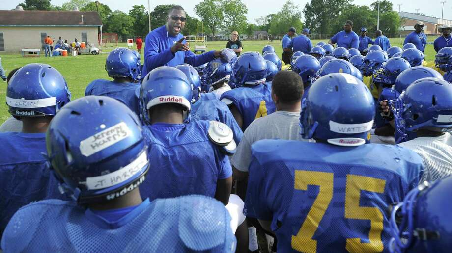 New Head Coach Keeath Magee, center, talks to his players about being a family and watching out for each other.  Monday afternoon, April 29, 2013, was the first day of spring football practice for the Ozen football team under the direction of new head coach Keeath Magee.    Dave Ryan/The Enterprise Photo: Dave Ryan