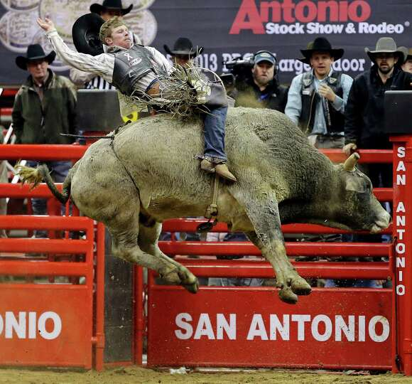 Steve Woolsey, of Payson, UT, competes in the bull riding event during the San Antonio Stock Show &