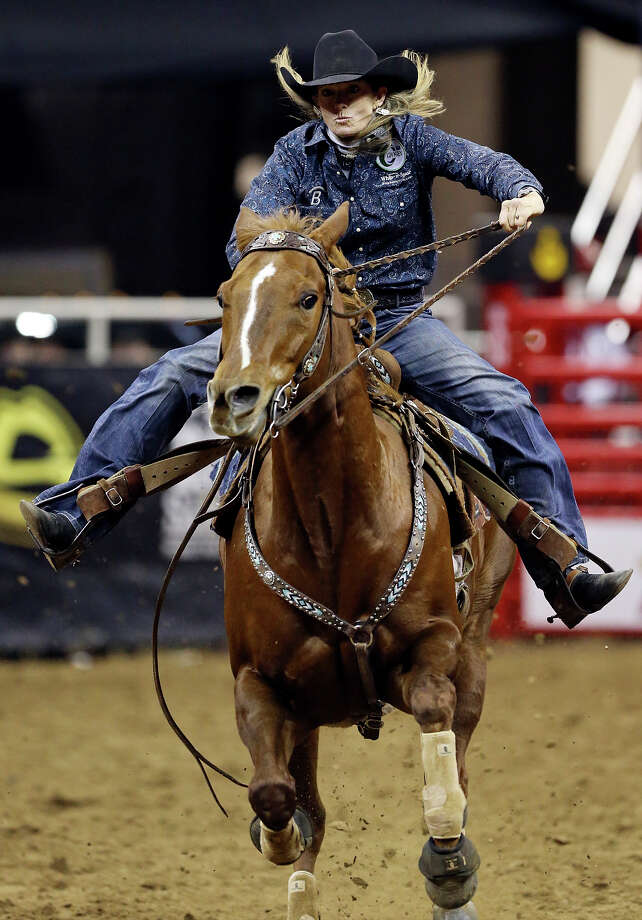 Jana Bean, of Ft. Hancock, TX, competes in the barrel racing event during the San Antonio Stock Show & Rodeo Monday Feb. 10, 2014 at the AT&T Center. Bean's time was 13.89 seconds. Photo: Edward A. Ornelas, San Antonio Express-News / © 2014 San Antonio Express-News