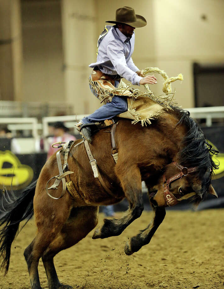 Levi Berry, of Morgan, UT, competes in the saddle bronc riding event during the San Antonio Stock Show & Rodeo Monday Feb. 10, 2014 at the AT&T Center. Berry scored an 84 on the ride. Photo: Edward A. Ornelas, San Antonio Express-News / © 2014 San Antonio Express-News