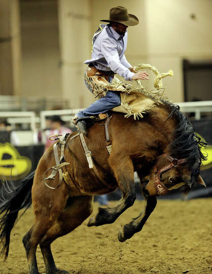 Levi Berry, of Morgan, UT, competes in the saddle bronc riding event during the San Antonio Stock Sh