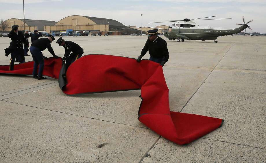 The red carpet for French President Francois Hollande blows in the wind as Marine One carrying U.S. President Barack Obama taxis to a stop at Andrews Air Force Base outside Washington, February 10, 2014. The two leaders will board Air Force One and visit the Virginia residence of Thomas Jefferson at Monticello in Charlottesville.   REUTERS/Larry Downing (UNITED STATES - Tags: POLITICS TPX IMAGES OF THE DAY) Photo: Larry Downing, Reuters