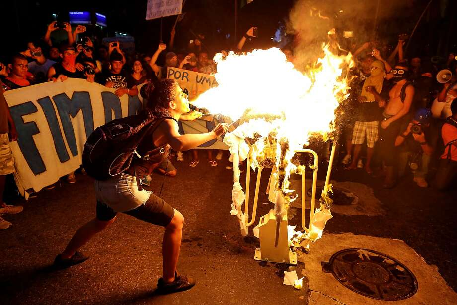 Incendiary words: In Rio de Janeiro, a fire spitter torches a bus turnstile to protest Rio's decision to 