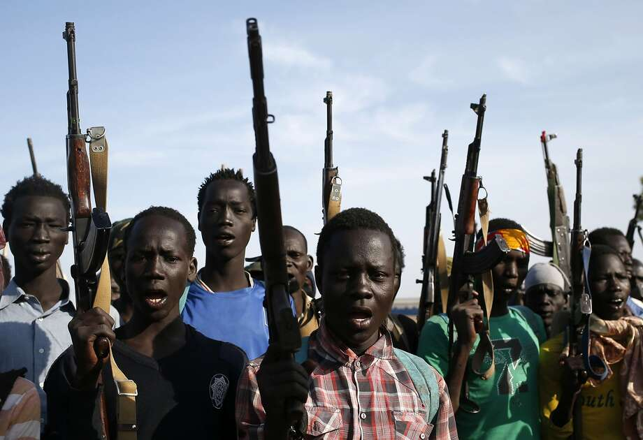 Jikany Nuer White Army fighters hold their weapons in Upper Nile State, February 10, 2014. 