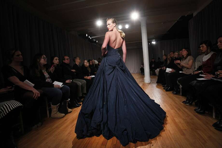 The Zac Posen Fall 2014 collection is modeled during Fashion Week in New York, Monday, Feb. 10, 2014. (AP Photo/Jason DeCrow) Photo: Jason DeCrow, Associated Press