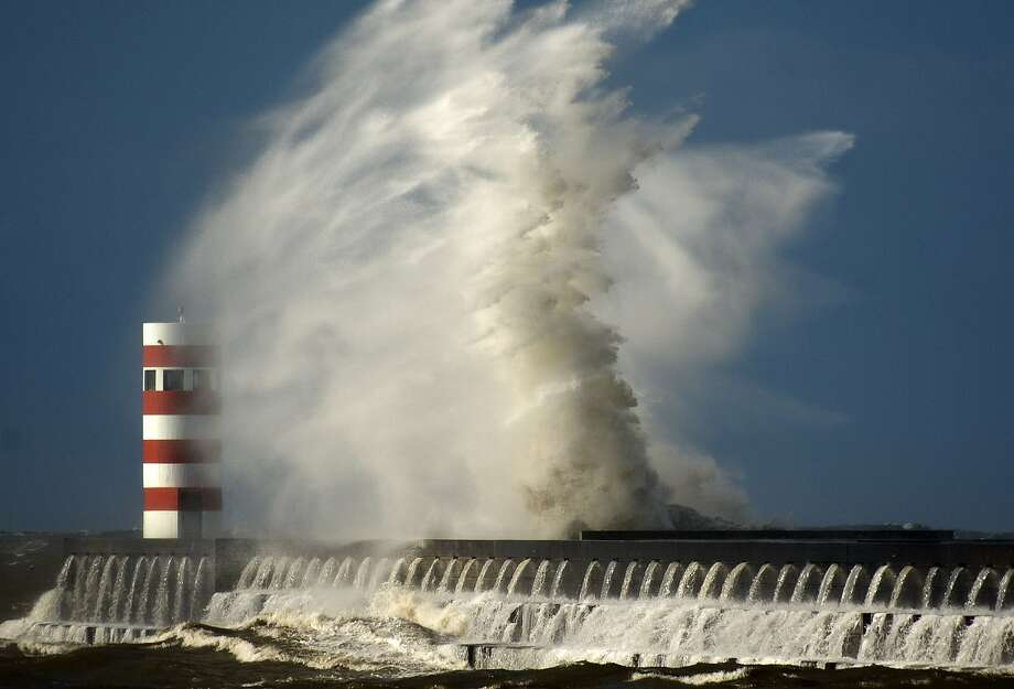 Rough waves pound the pier at Douro's river mouth in Porto, Portugal, Monday Feb. 10, 2014.  The Portuguese weather institute put the entire coast of Portugal on red alert, the most serious in a scale of four, due to rough seas and gale force winds as storm Stephanie moves in.(AP Photo/Paulo Duarte) Photo: Paulo Duarte, Associated Press