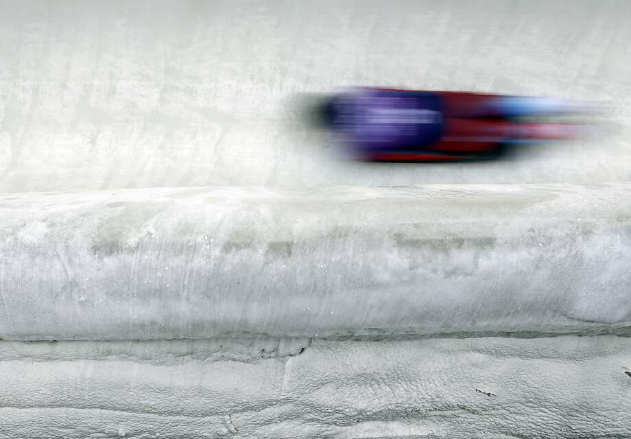 Nikita Tregybov of Russia speeds down the track during the men's skeleton training session at the 2014 Winter Olympics, Monday, Feb. 10, 2014, in Krasnaya Polyana, Russia. (AP Photo/Natacha Pisarenko) Photo: Natacha Pisarenko, Associated Press