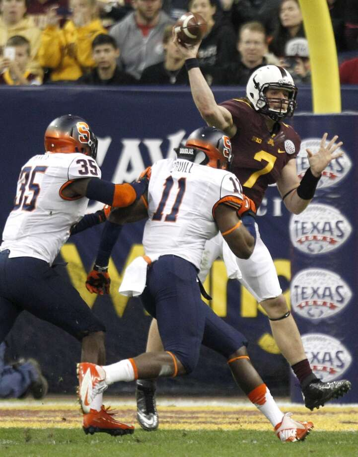 Minnesota quarterback Mitch Leidner (7) throws a pass as he is pressured by Syracuse linebacker Dyshawn Davis (35) and linebacker Marquis Spruill (11) during the second quarter of the Texas Bowl at Reliant Stadium, Friday, Dec. 27, 2013, in Houston. ( Brett Coomer / Houston Chronicle ) Photo: Brett Coomer, Houston Chronicle