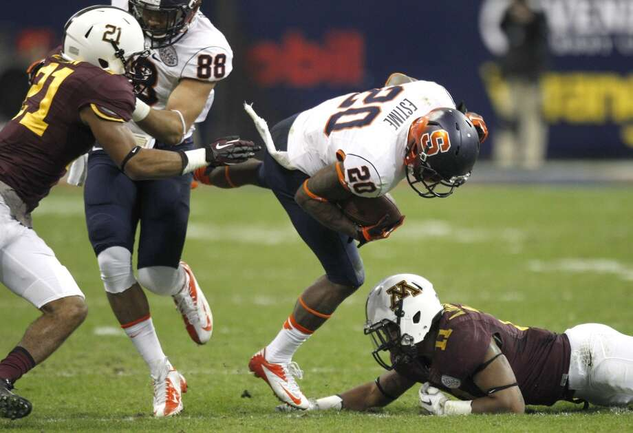 Syracuse wide receiver Brisly Estime (20) is tripped up by Minnesota defensive back Antonio Johnson (11) during the second quarter of the Texas Bowl at Reliant Stadium, Friday, Dec. 27, 2013, in Houston. ( Brett Coomer / Houston Chronicle ) Photo: Brett Coomer, Houston Chronicle