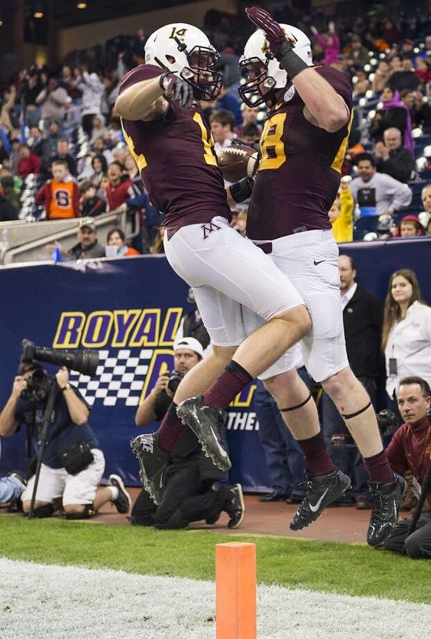Minnesota tight end Maxx Williams (88) celebrates with wide receiver Isaac Fruechte (14) after scoring on a 20-yard touchdown catch during the second half of the Texas Bowl at Reliant Stadium, Friday, Dec. 27, 2013, in Houston. ( Smiley N. Pool / Houston Chronicle ) Photo: Smiley N. Pool, Houston Chronicle