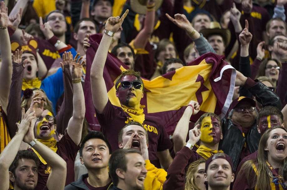 Minnesota fans cheer a touchdown during the second half of the Texas Bowl at Reliant Stadium, Friday, Dec. 27, 2013, in Houston. ( Smiley N. Pool / Houston Chronicle ) Photo: Smiley N. Pool, Houston Chronicle