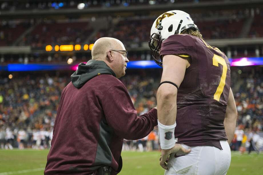 Minnesota head coach Jerry Kill talks with quarterback Mitch Leidner (7) on the sidelines during the second half of the Texas Bowl at Reliant Stadium, Friday, Dec. 27, 2013, in Houston. ( Smiley N. Pool / Houston Chronicle ) Photo: Smiley N. Pool, Houston Chronicle