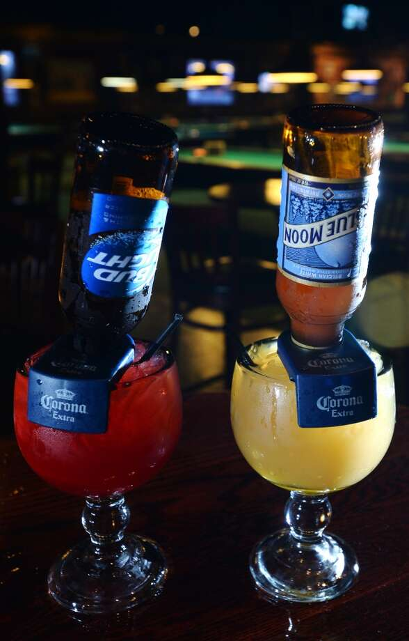 Pictured are Balls of Fire, left, and Lost at Sea beer cocktails. The Balls of Fire is made with Fireball whiskey, cranberry juice, and a Bud Light. The Lost at Sea is made with Sailor Jerry rum, agave nectar, orange juice, and a Blue Moon. The Lost at Sea and Balls of Fire beer cocktails are available at Fast Eddie's. Photo taken Monday, 1/27/14 Jake Daniels/@JakeD_in_SETX