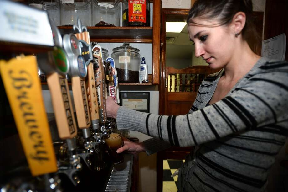 Tiffany Ritchie pours a Buried Hatchet stout to be matched with St. Arnold's root beer and a shot of espresso while making the Logon Cafe's Buzz Brew.  Photo taken January 29, 2014 Guiseppe Barranco/@spotnewsshooter
