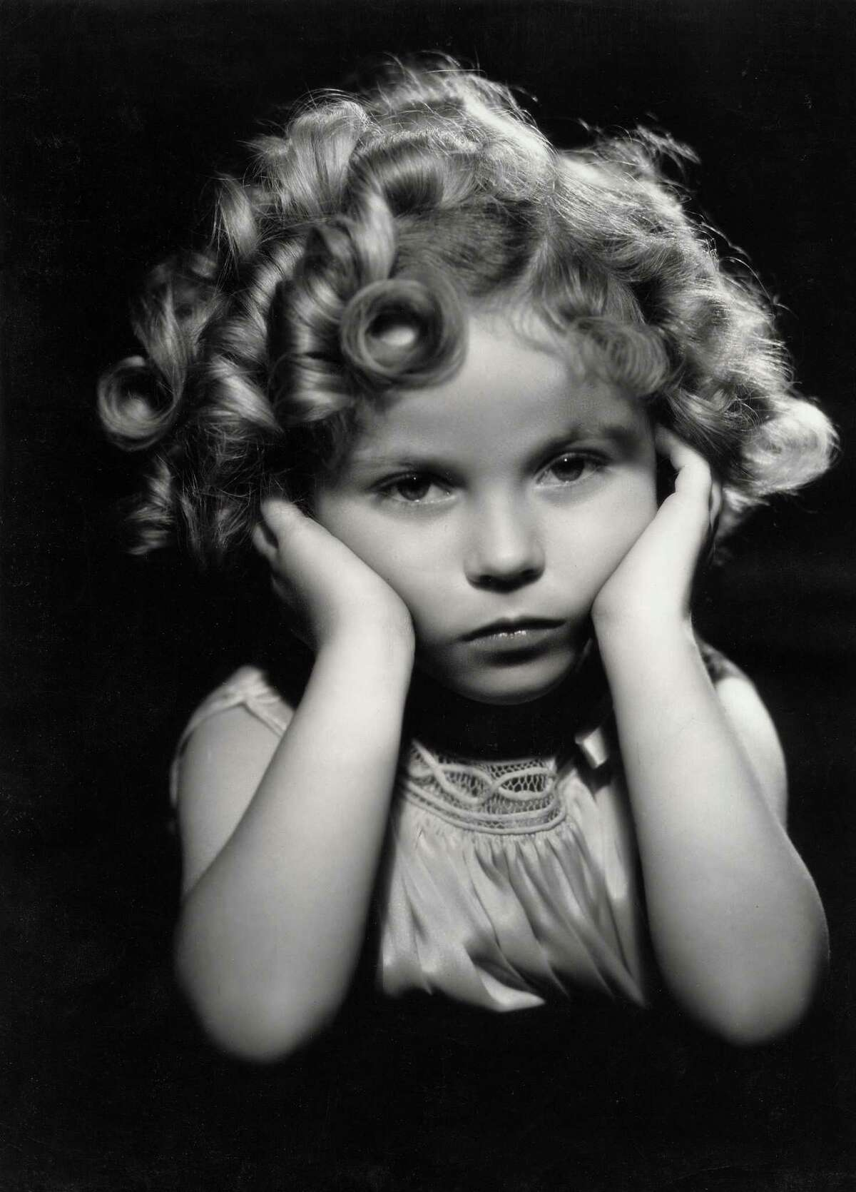 1933: Child actress Shirley Temple in one of her famous poses.