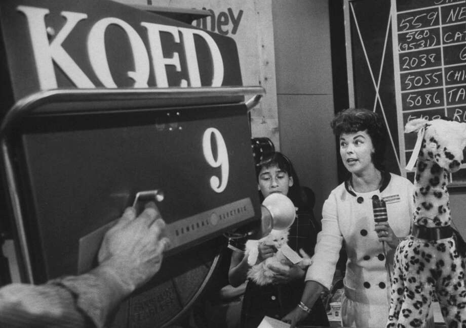 1963: Actress Shirley Temple (R) auctioneering to raise money for KQED TV station. Photo: Nat Farbman, Time & Life Pictures/Getty Image / Nat Farbman