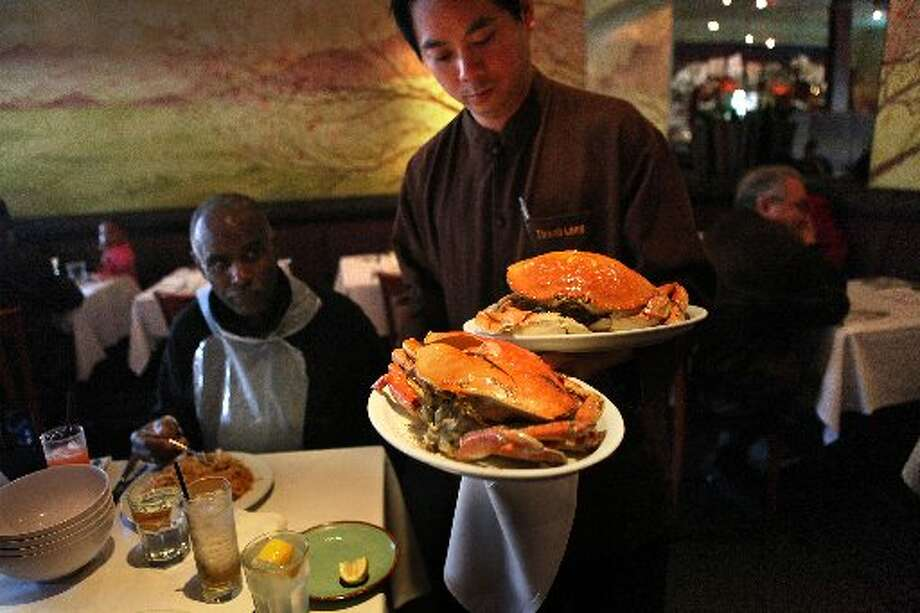 Serving the crab at Thanh Long. Photo: Liz Hafalia, The San Francisco Chronicle