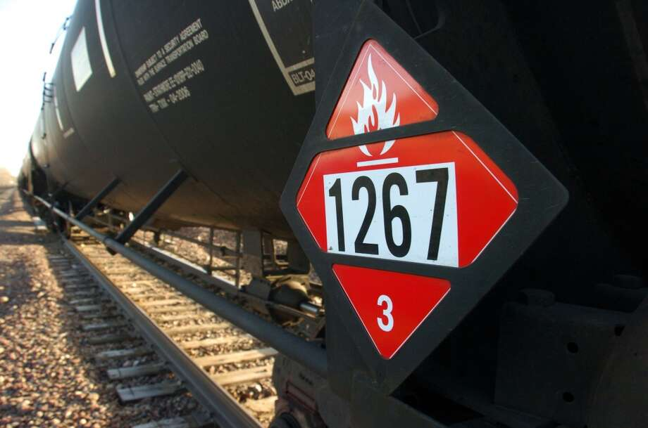 A placard on a tank car carrying crude oil near a loading terminal in Trenton, N.D. warns of flammability. Photo: Matthew Brown, ASSOCIATED PRESS