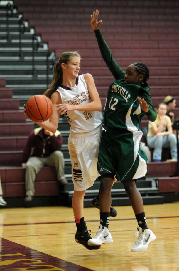 Magnolia West sophomore point guard Carissa Williams, left, averaged 6.0 assists per game this season for the Mustangs. Photo: Jerry Baker, Freelance