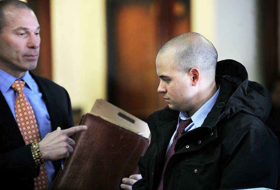 Standing with his lawyer, Bruce Koffsky, left, Manny Ramos is arraigned in Superior Court in Bridgeport, Conn. on Tuesday, February 11, 2014. Photo: Brian A. Pounds / Connecticut Post