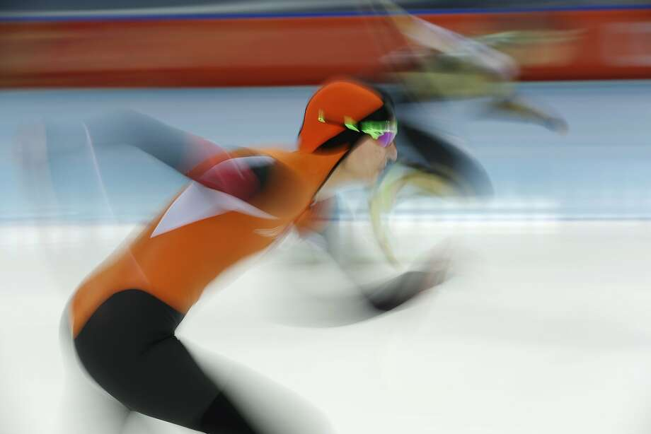 Margot Boer of the Netherlands, foreground and Nao Kodaira of Japan take the start in the first heat of the women's 500-meter speedskating race at the Adler Arena Skating Center during the 2014 Winter Olympics, Tuesday, Feb. 11, 2014, in Sochi, Russia. Photo: Pavel Golovkin, Associated Press