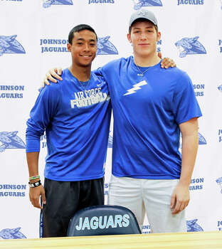 Johnson's Darion McElhannon (left) and J.C. Rast pose together after signing their national letters of commitment to play football at the Air Force Academy in the Johnson High School gym on national signing day, Wednesday, Feb. 5, 2013.  Photo by Marvin Pfeiffer / EN Communities Photo: MARVIN PFEIFFER, Marvin Pfeiffer / EN Communities / EN Communities 2014
