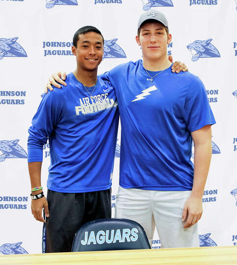 Johnson's Darion McElhannon (left) and J.C. Rast pose together after signing their national letters