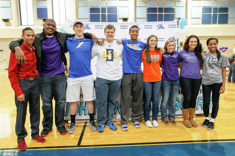 Johnson's (from left) Robert Ford (track-USC), Robert Ballard (football-Stephen F. Austin), J.C. Rast (footbal-Air Force Academy_, Jeremiah McCutcheon (football-Wayland Baptist), Darion McElhannon (football-Air Force Academy), Caitlin Schwarz (soccer-Sam Houston State), Sarah Fish (soccer-Ouchita Baptist), Tiana Soulas (soccer-Ouchita Baptist) and Nia Stallings (soccer-Rice) signed their national letters of commitment in the Johnson High School gym on national signing day, Wednesday, Feb. 5, 2013.  Photo by Marvin Pfeiffer / EN Communities Photo: MARVIN PFEIFFER, Marvin Pfeiffer / EN Communities / EN Communities 2014