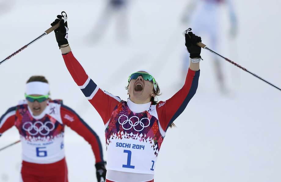Norway's Maiken Caspersen Falla crosses the finish line to win gold in the final of the women's cross-country sprint at the 2014 Winter Olympics, Tuesday, Feb. 11, 2014, in Krasnaya Polyana, Russia.  Photo: Matthias Schrader, Associated Press