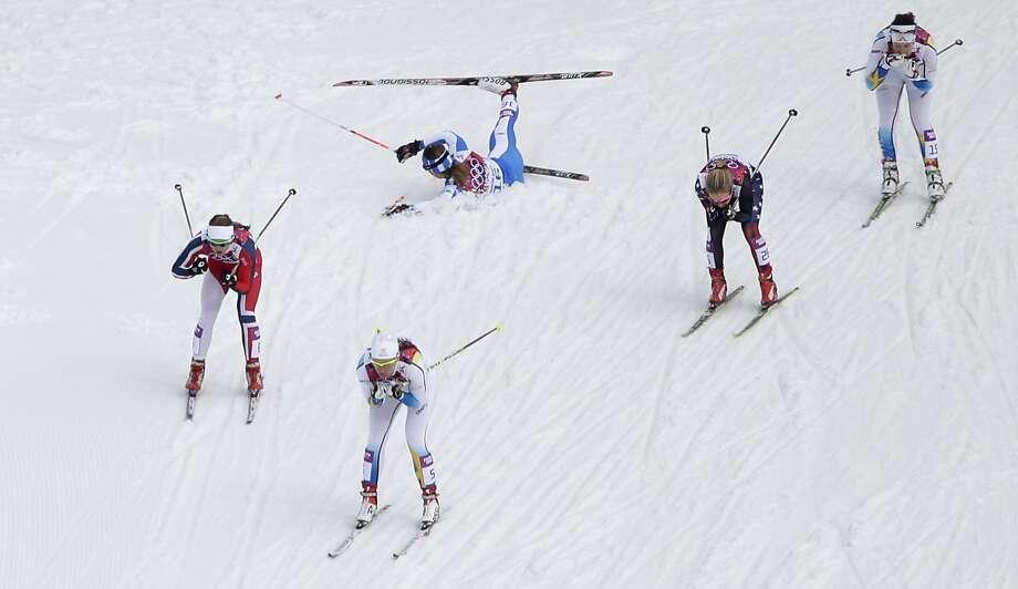Italy's Greta Laurent, top left, as, from left, Norway's Ingvild Flugstad Oestberg, Sweden's Ida Ingemarsdotter, Canada's Daria Gaiazova, and Sweden's Norgren Britta Johansson pass by during their women's quarterfinal heat of the cross-country sprint at the 2014 Winter Olympics, Tuesday, Feb. 11, 2014, in Krasnaya Polyana, Russia.  Photo: Matthias Schrader, Associated Press
