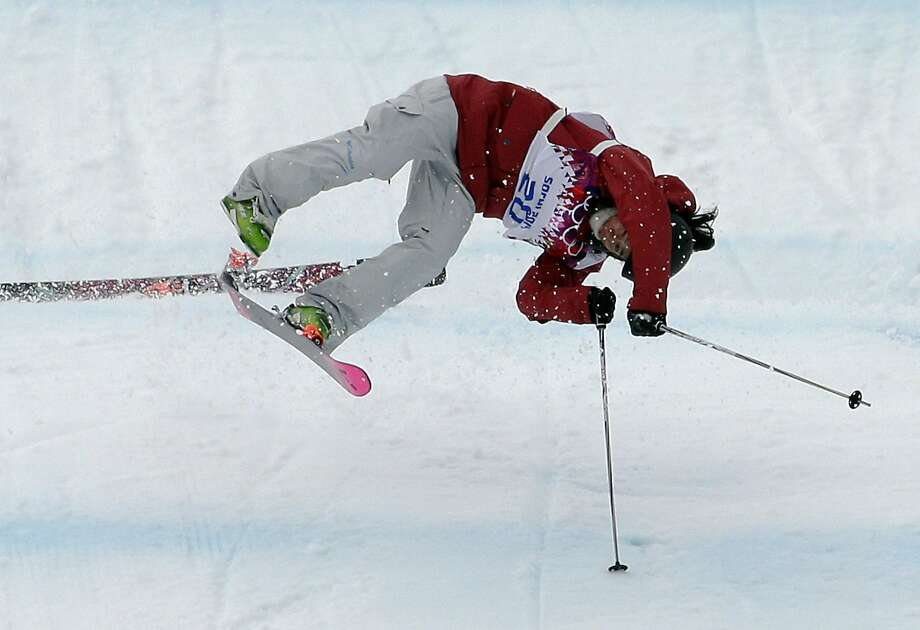 Canada's Yuki Tsubota crashes on her last run in the women's freestyle skiing slopestyle final at the Rosa Khutor Extreme Park, at the 2014 Winter Olympics, Tuesday, Feb. 11, 2014, in Krasnaya Polyana, Russia.  Photo: Andy Wong, Associated Press