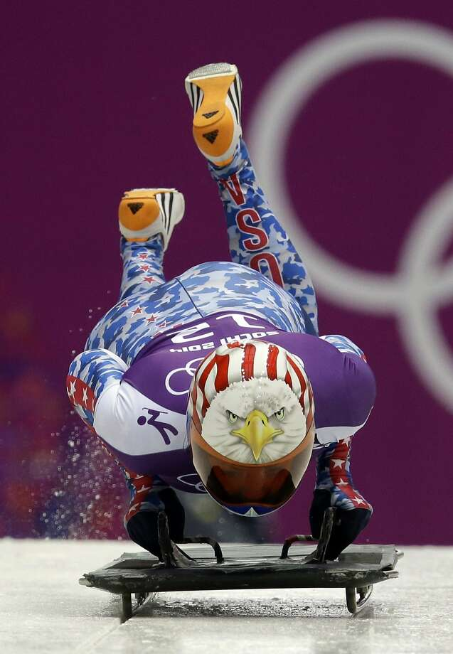 Katie Uhlaender of the United States starts a run during women's skeleton training  at the 2014 Winter Olympics, Tuesday, Feb. 11, 2014, in Krasnaya Polyana, Russia.  Photo: Dita Alangkara, Associated Press