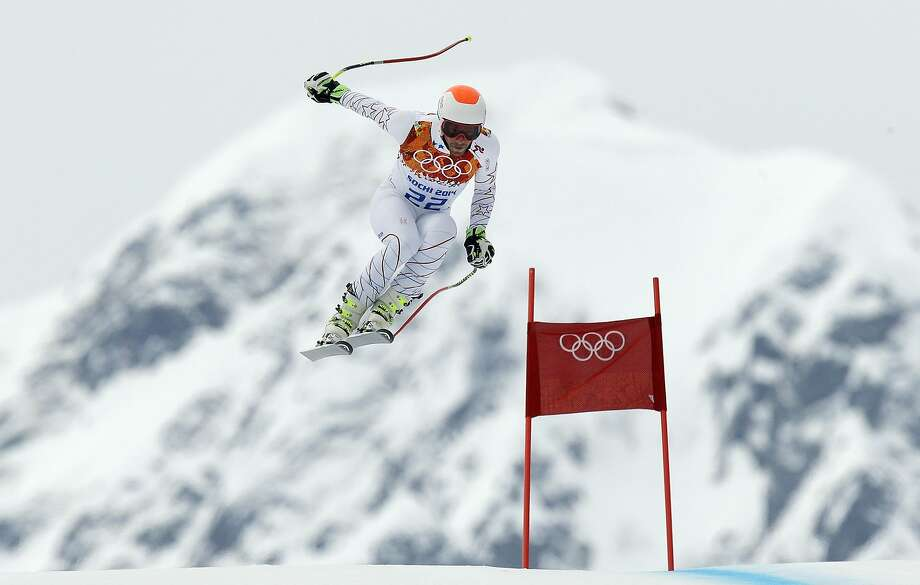 Bode Miller of the United States makes a jump during men's super combined downhill training at the Sochi 2014 Winter Olympics, Tuesday, Feb. 11, 2014, in Krasnaya Polyana, Russia. Photo: Luca Bruno, Associated Press