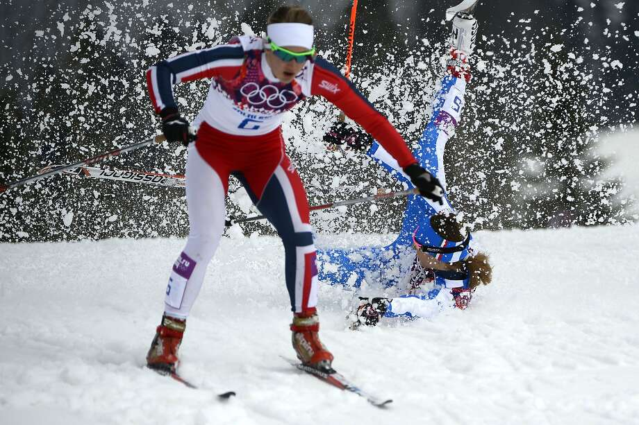 Italy's Greta Laurent falls as Norway's Ingvild Flugstad Oestberg skis past as they compete in the Women's Cross-Country Skiing Individual Sprint Free Quarterfinals at the Laura Cross-Country Ski and Biathlon Center during the Sochi Winter Olympics on February 11, 2014 in Rosa Khutor near Sochi.  Photo: Pierre-philippe Marcou, AFP/Getty Images