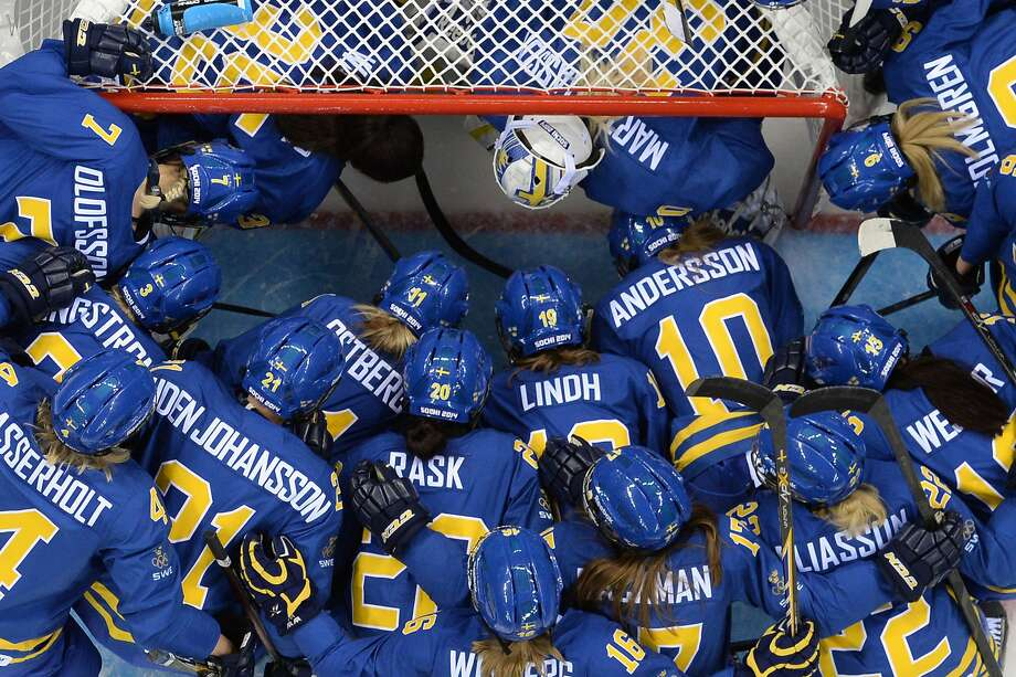 Sweden's players gather before the start of the Women's Ice Hockey Group B match Germany vs Sweden at the Shayba Arena during the Sochi Winter Olympics on February 11, 2014. Photo: Jonathan Nackstrand, AFP/Getty Images