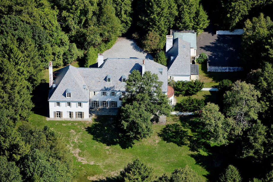 FILE - This photo provided in 2010 by Barbara Cleary's Realty Guild shows the estate of Huguette Clark in New Canaan. Cleary said after nine years on the market, the estate's sale is pending. (AP Photo/File) Photo: Anonymous, ASSOCIATED PRESS / AP2010