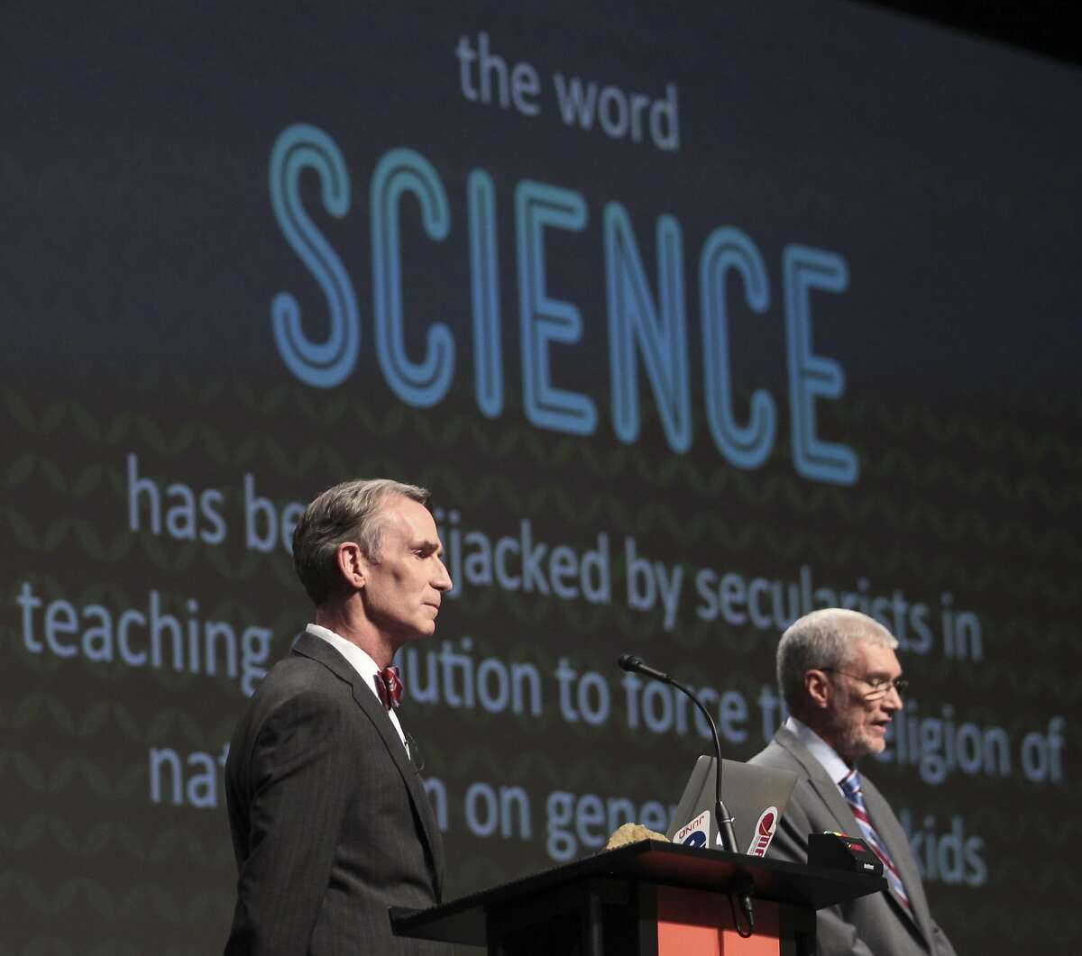 Creation Museum head Ken Ham, right, speaks during a debate on evolution with TV's
