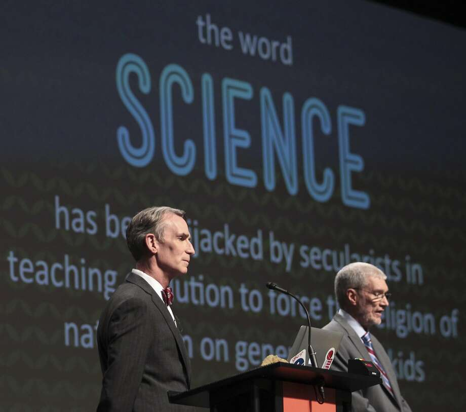 "Bill Nye ""the Science Guy"" (left) listens as Ken Ham makes a point this month at a debate on evolution at Ham's Creation Museum in Petersburg, Ky. Photo: Matt Stone, Associated Press"