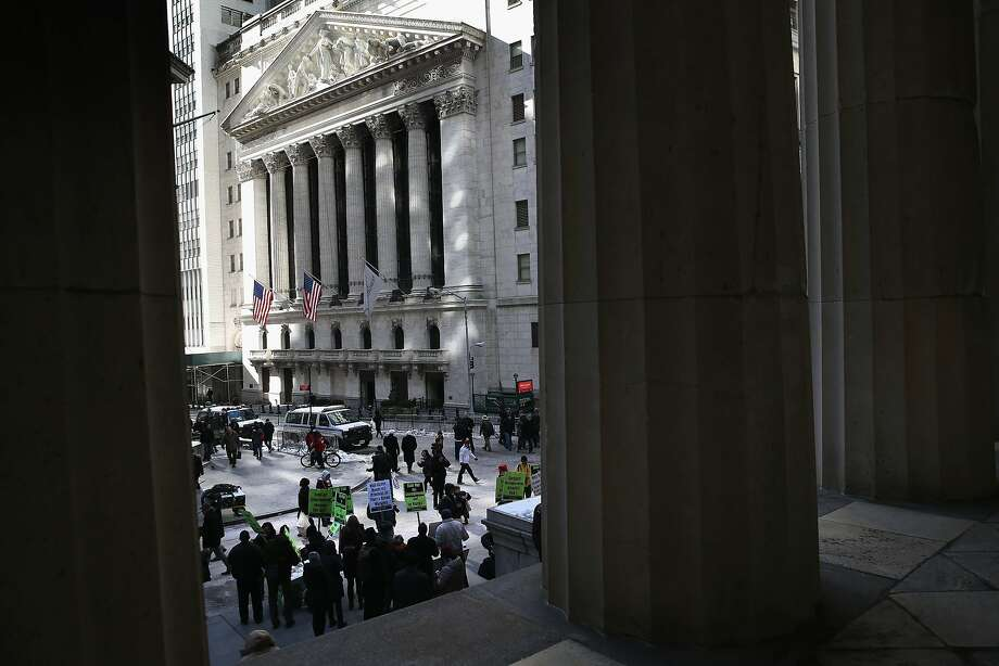 "Protesters hold a ""Rise Up for the Unemployed"" rally across from the New York Stock Exchange on Feb. 7. Photo: John Moore, Getty Images"