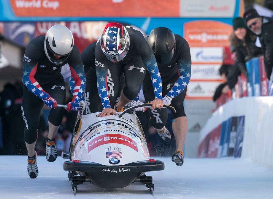 Nick Cunningham, Justin Olsen, Johnny Quinn and Dallas Robinson from the USA start in the first run of the four-man bobsled World Cup Jan. 12 in St. Moritz, Switzerland. Photo: Associated Press / KEYSTONE