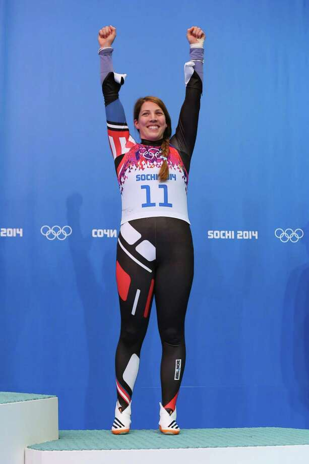 SOCHI, RUSSIA - FEBRUARY 11:  Bronze medalist Erin Hamlin of the United States celebrates during the flower ceremoy for the Women's Luge Singles on Day 4 of the Sochi 2014 Winter Olympics at Sliding Center Sanki on February 11, 2014 in Sochi, Russia.  (Photo by Alex Livesey/Getty Images) ORG XMIT: 461629471 Photo: Alex Livesey, Getty / 2014 Getty Images