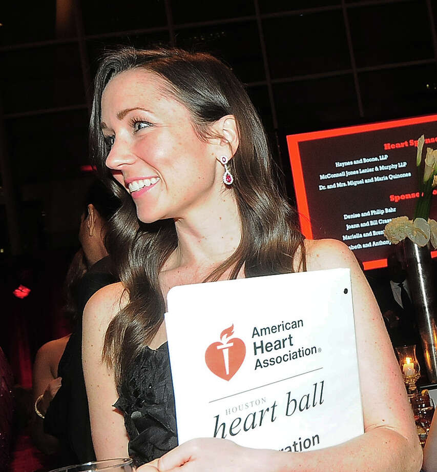 Katie Pryor models the $24,500 ruby and diamond earrings up for auction at the American Heart Association's 31st Annual Houston Heart Ball at The Hobby Center Saturday 02/08/14. Photo by Tony Bullard. Photo: © Tony Bullard 2014, For The Chronicle / © 2014 Tony Bullard