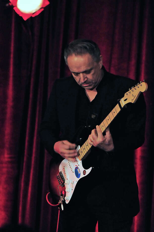 Jimmie Vaughan plays his signed guitar to start the bidding during the live auction at the American Heart Association's 31st Annual Houston Heart Ball at The Hobby Center Saturday 02/08/14. Photo by Tony Bullard. Photo: © Tony Bullard 2014, For The Chronicle / © 2014 Tony Bullard