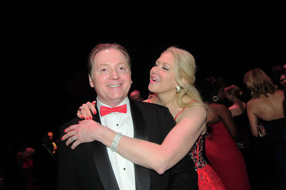 Marathon Oil's Lee Tillman gets a hug from his wife Ty Tillman at the American Heart Association's 31st Annual Houston Heart Ball at The Hobby Center Saturday 02/08/14. Photo by Tony Bullard. Photo: © Tony Bullard 2014, For The Chronicle / © 2014 Tony Bullard
