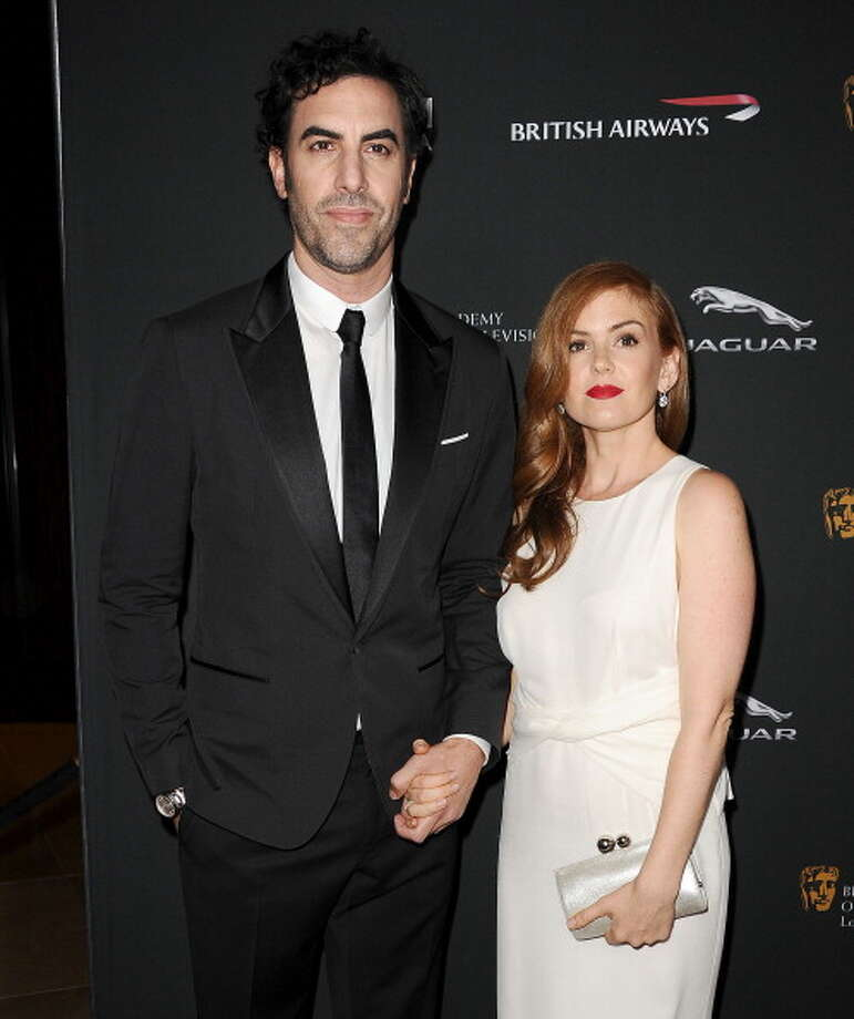 Tall celebs like Sasha Baron Cohen will likely always tower over their significant others, in his case - Isla Fisher. Check out other celebrity couples with major height differences. Photo: Getty Images / 2013 Jason LaVeris