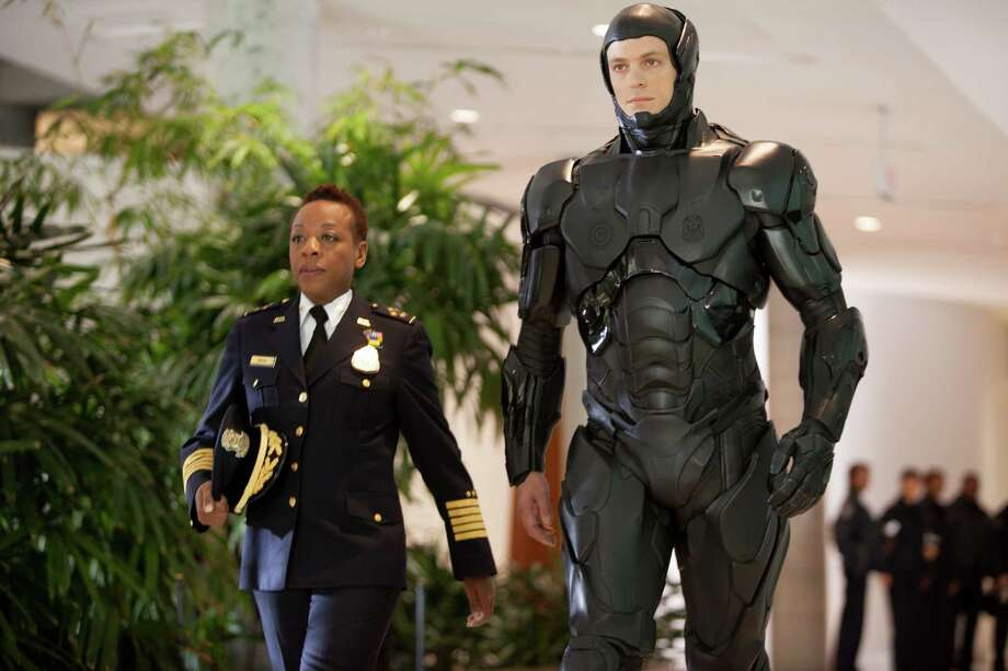 "This image released by Columbia Pictures shows Marianne Jean-Baptiste, left, and Joel Kinnaman in a scene from ""RoboCop."" (AP Photo/Columbia Pictures - Sony, Kerry Hayes) ORG XMIT: NYET116 Photo: Kerry Hayes / Columbia Pictures Sony"