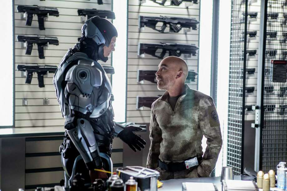 "Jackie Earle Haley, at right in a scene from the new ""RoboCop"", is also known for his role as Rorschach in ""Watchmen"" and for his time as a child actor. Haley now lives in San Antonio. Photo: Kerry Hayes / Columbia Pictures Sony"